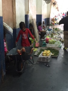 Kids playing next to fresh veggies